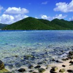 pale-blue-sea-with-green-mountain - 58126
