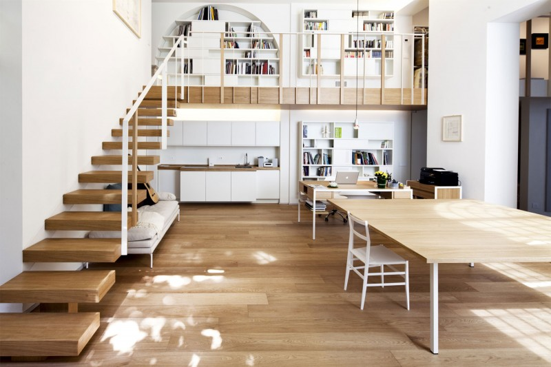 ������ ٢٠١٤ ����� ������ ٢٠١٤ beautiful-view-of-the-living-room-with-brown-parquet-combined-with-wooden-material-staircase-and-white-iron-bars-with-built-in-bookshelf-a-far.jpg
