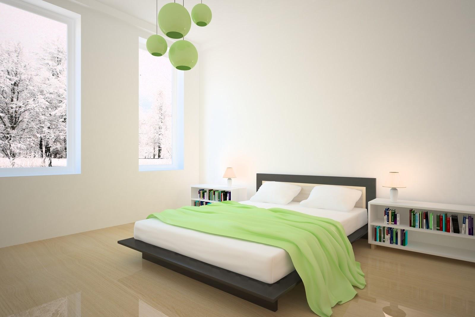 نجفة مميزة باللون الاخضر بغرفة النوم البسيطة