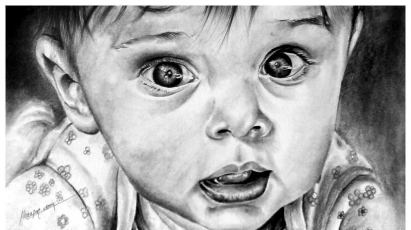 وجه طفل صغير مرسوم  بالقلم الرضاص