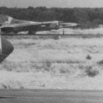 LARAF MiG-23MS with empty missile rails rolling along the runway at Faya Largeau AB, sometimes in mid-1980 - 148453