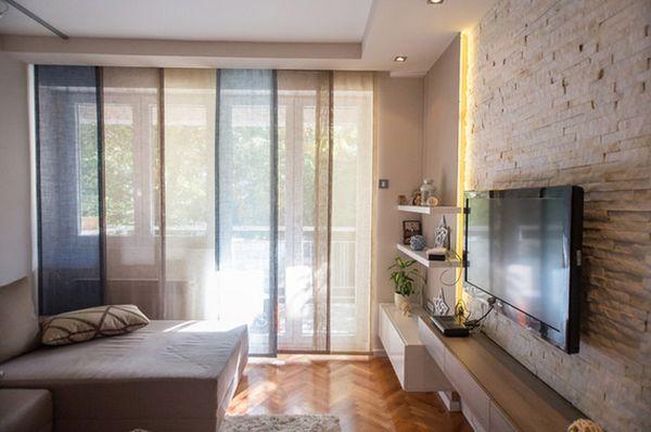 جدران حجرية خلفية للبلازما بغرفة الجلوس المرسال
