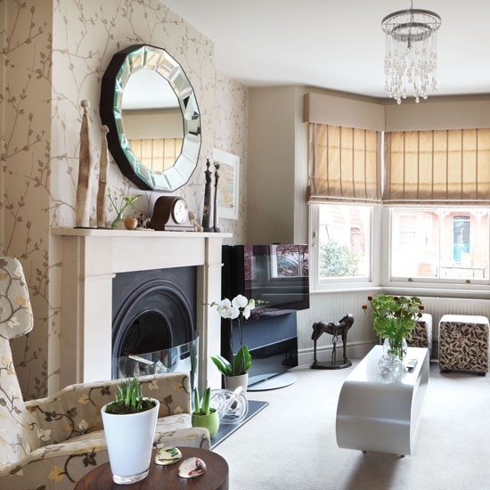 Living room with neutral wallpaper