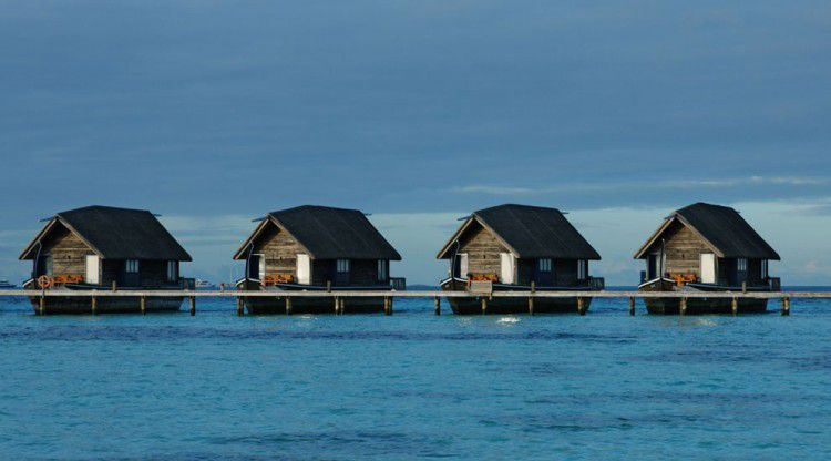 Cocoa Island Resort is ideally located along crystal-clear waters