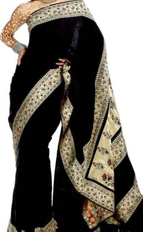 f2beb63f8663a ... الهندي التقليدي الذي يحمل نفس النقوشات البراقة . فستان أسود