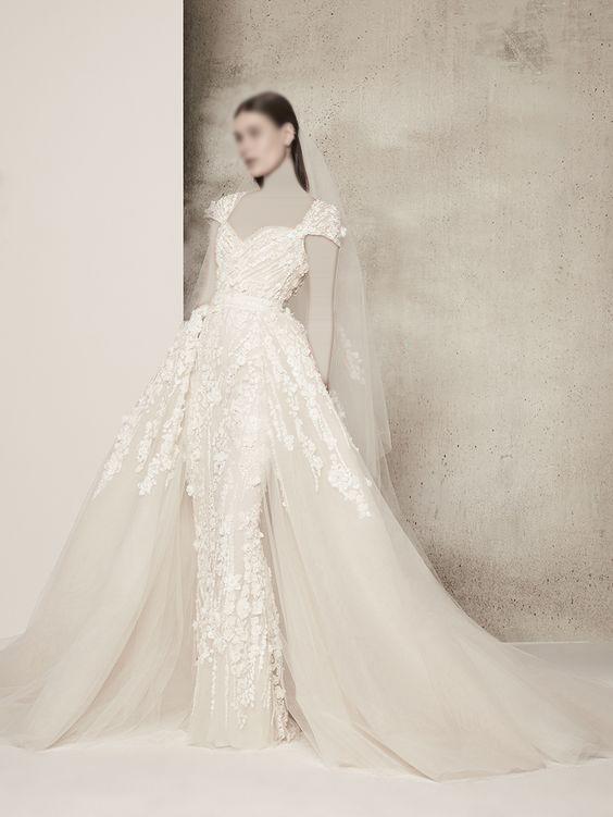 فستان زفاف ضيق من الامام و منفوش من الخلف