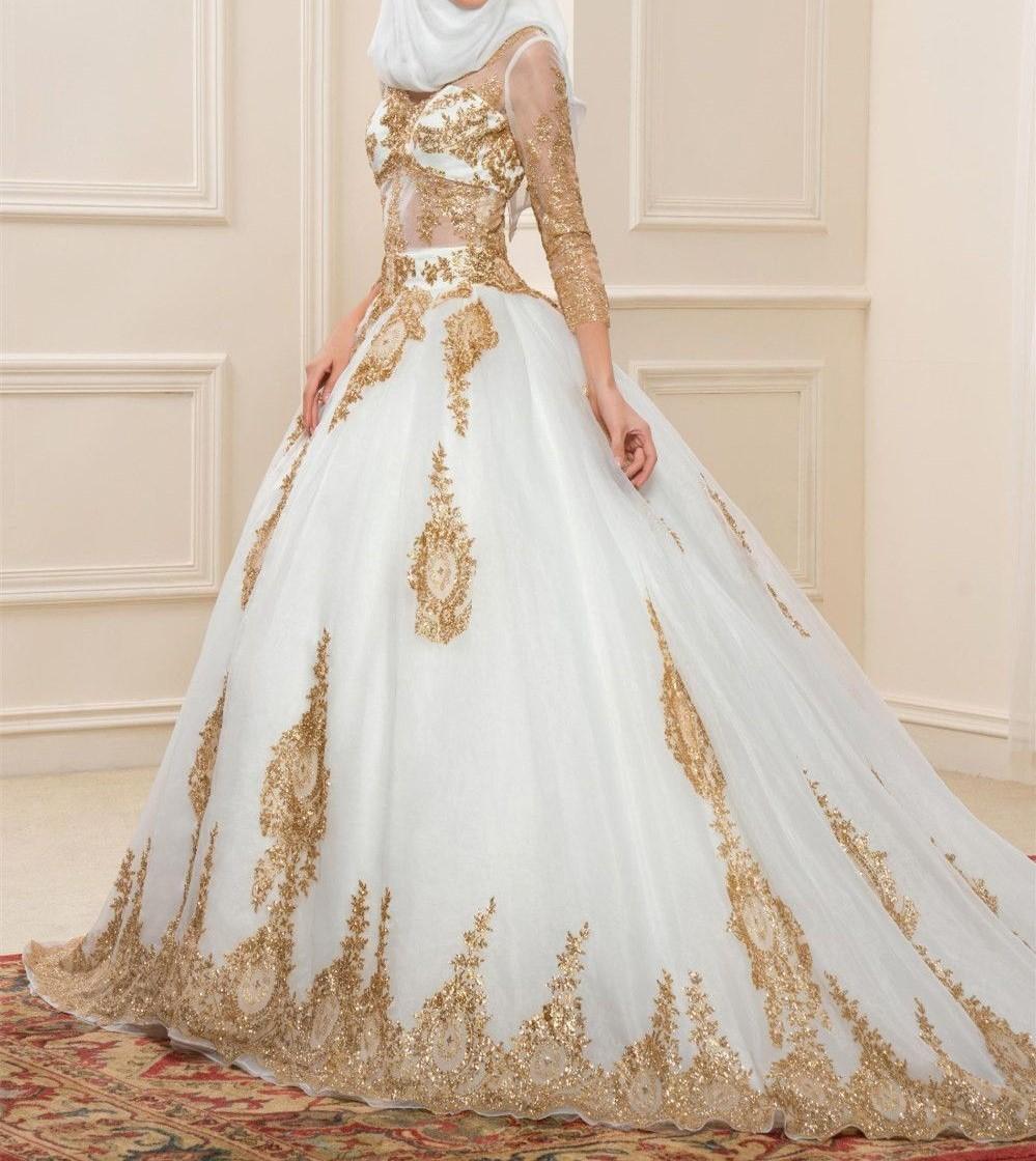 فستان زفاف للمحجبات بتطريز ذهبي